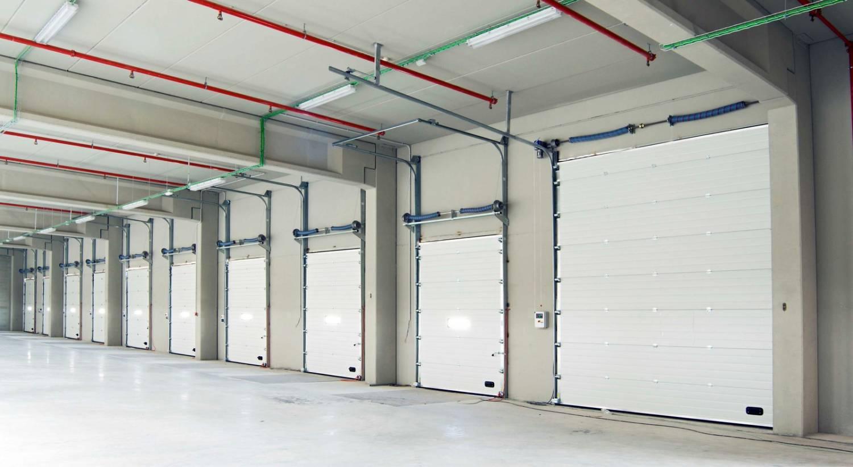 Puertas seccionales tecnomateriales for Puertas industriales
